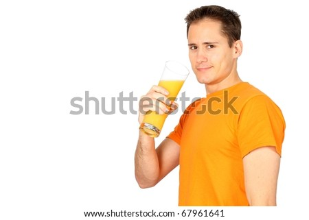 Handsome young man drinking orange juice with lots of copyspace - stock photo