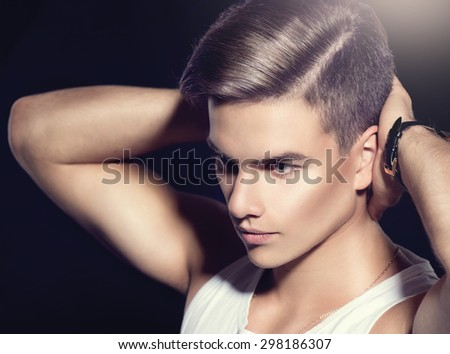 Handsome young man. Fashion young model man portrait. Handsome Guy. Vogue style image of elegant boy. fashion Hairstyle, haircut.  - stock photo