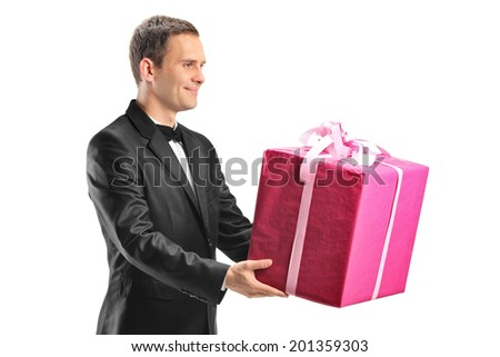Handsome young man holding a big present isolated on white background - stock photo