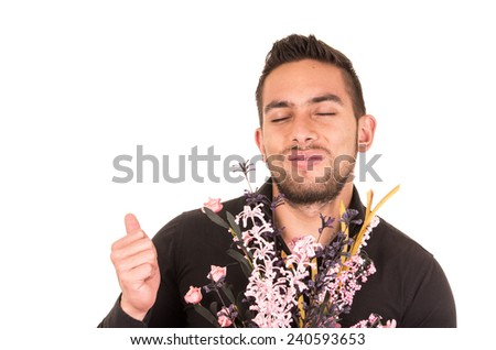 handsome young man holding a flower bouquet holding thumb up isolated on white - stock photo