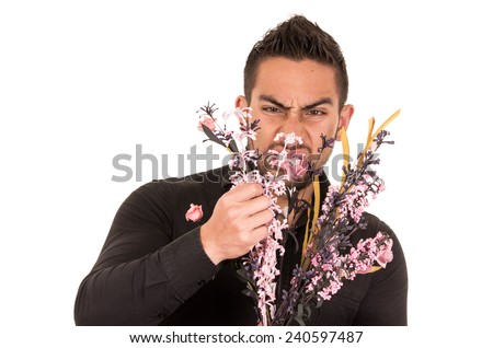 handsome young man holding a flower bouquet looking disgusted isolated on white - stock photo