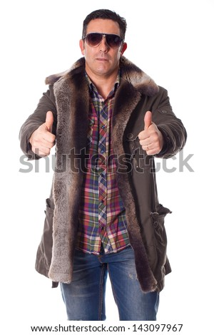 Handsome young man in a winter clothing with positive attitude  - stock photo