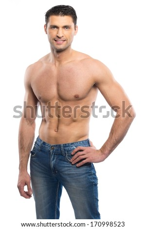 Handsome young man in blue jeans with naked torso - stock photo