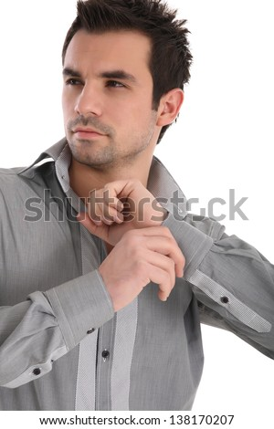 Handsome young man in shirt closing bottons - stock photo