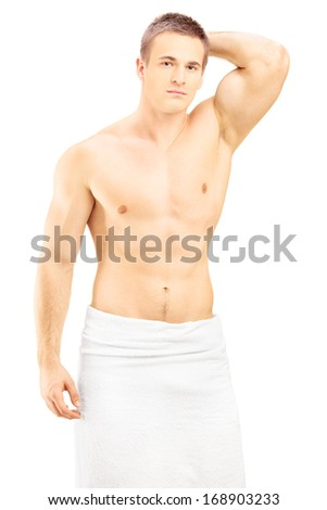 Handsome young man in white towel posing after shower, isolated against white background - stock photo