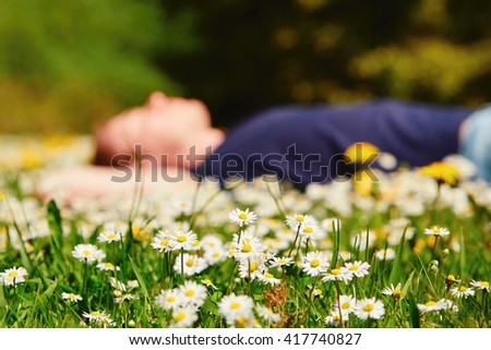 Handsome young man is enjoying sunny day - selective focus - stock photo