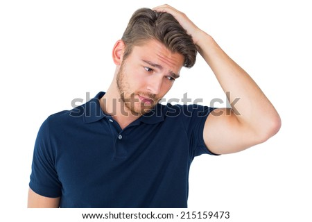 Handsome young man looking confused on white background - stock photo