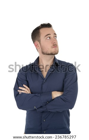 Handsome young man looking up against a white background - stock photo