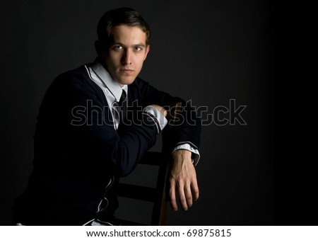 Handsome young man on black background. - stock photo