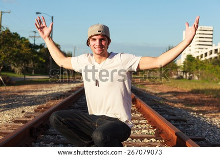 Handsome young man outdoor fashion portrait - stock photo