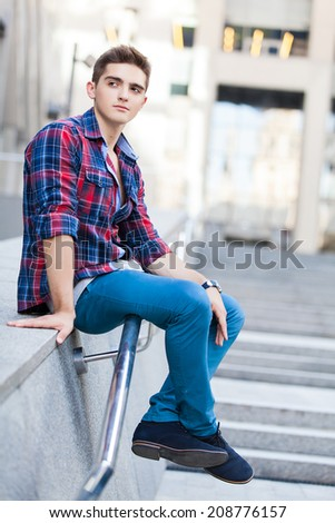 handsome young man outdoors - stock photo