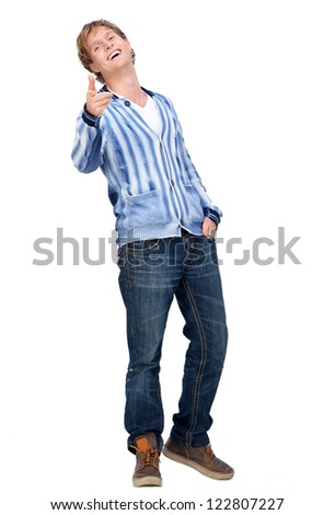 Handsome young man pointing his finger and looking at camera. Full body portrait of male model is smiling and isolated on white background. - stock photo