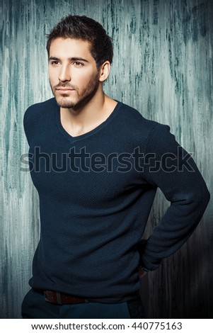 Handsome young man posing at studio. Men's beauty.  - stock photo