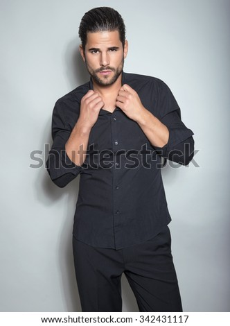 handsome young man posing in dress shirt - stock photo
