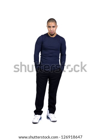 Handsome young man posing with hands in pocket while standing against white background - stock photo