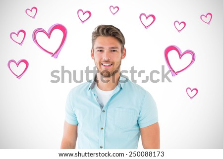 Handsome young man posing with hands in pockets against white background with vignette - stock photo