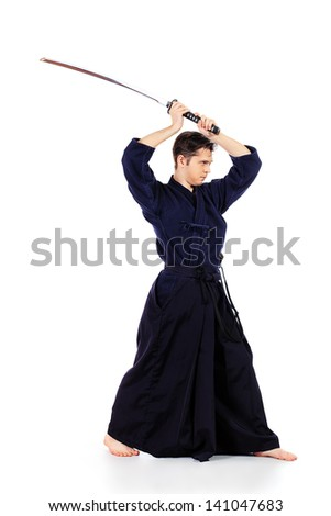 Handsome young man practicing kendo. Isolated over white. - stock photo