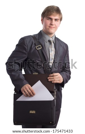 handsome young man pulls out a piece of paper out of the briefcase - stock photo