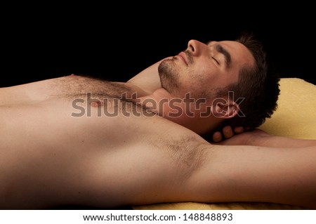 Handsome young man relaxing - stock photo