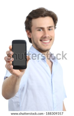 Handsome young man showing a blank smart phone screen isolated on a white background          - stock photo