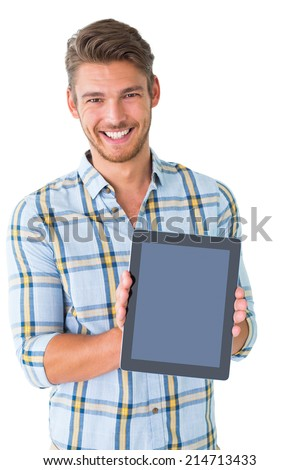 Handsome young man showing his tablet pc on white background - stock photo