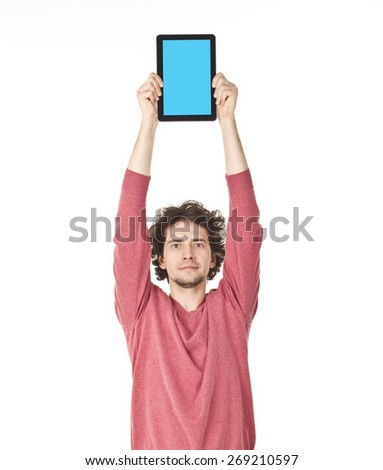 Handsome young man showing something on tablet. - stock photo
