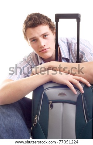 handsome young man sitting with the suitcase - stock photo