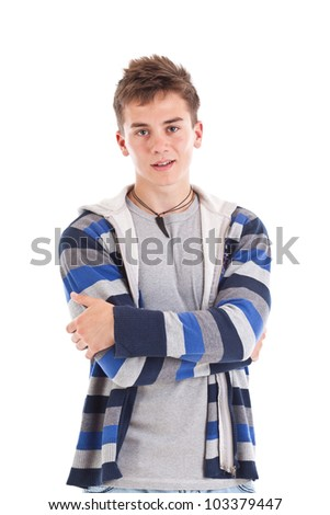 Handsome young man standing arms crossed - stock photo
