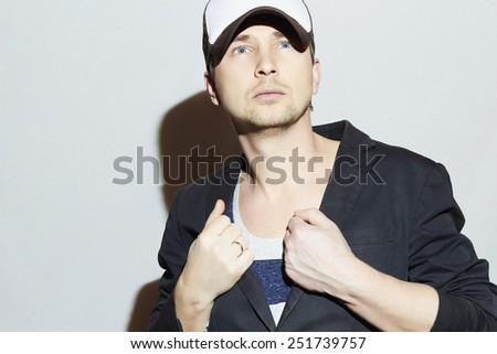 Handsome Young Man. Stylish Boy in cap. Casual Fashion.posing man model - stock photo