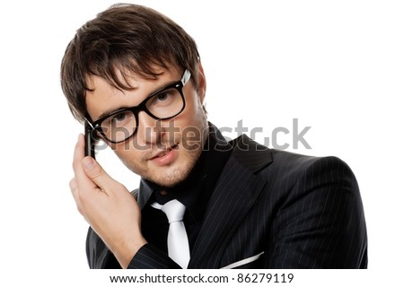 Handsome young man talking on a phone. - stock photo