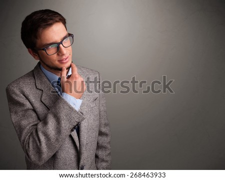 Handsome young man thinking with empty copy space - stock photo