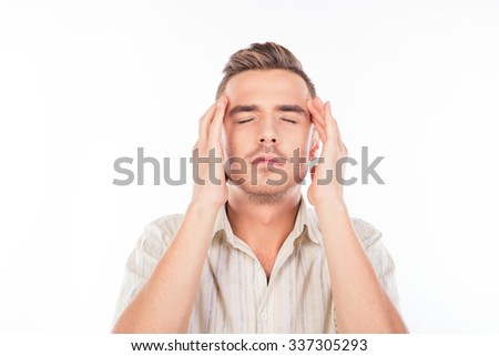 Handsome young man touching his head suffering from headache - stock photo