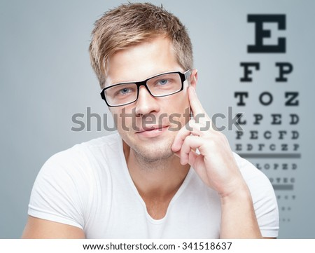 Handsome young man wearing glasses - stock photo