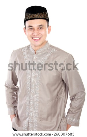 handsome young man wearing muslim dress posing on white background - stock photo