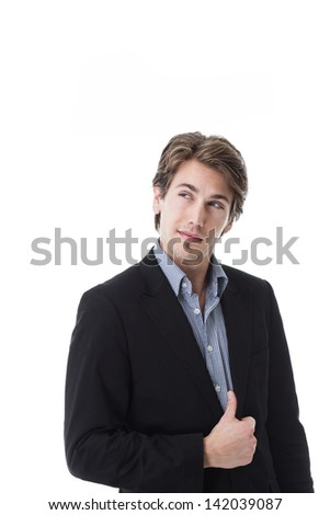 Handsome young man with a quizzical expression standing looking up into the air isolated on white - stock photo