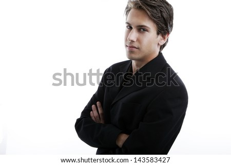 Handsome young man with attitude, arms crossed - stock photo