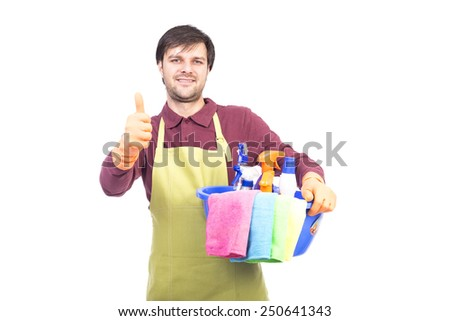Handsome young man with cleaning equipment holding thumb up ready to clean the house over white - stock photo