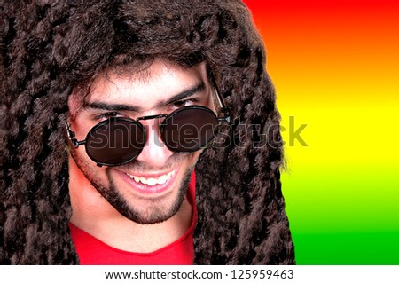 handsome young man with dreadlocks - stock photo