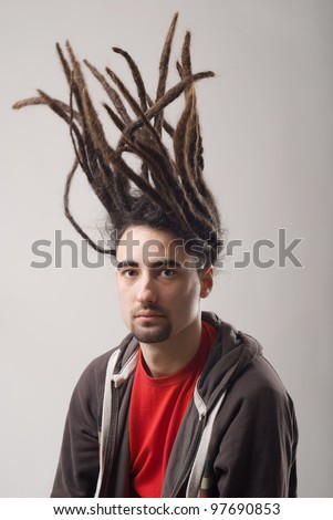 handsome young man with flying dreadlocks - stock photo