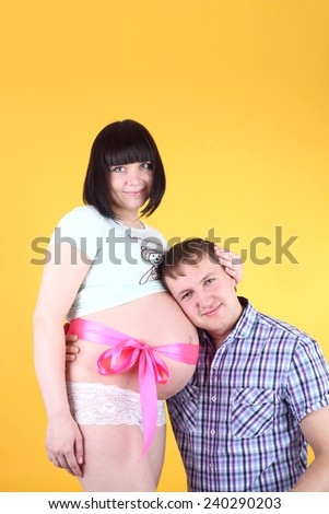 handsome young man with his pregnant wife - stock photo