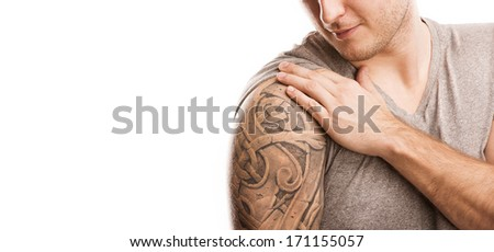 Handsome young man with tattoo, isolated on white. - stock photo