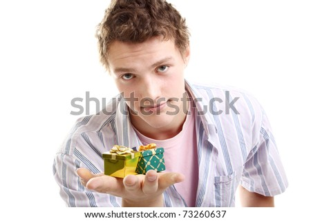handsome young man with two little presents - stock photo