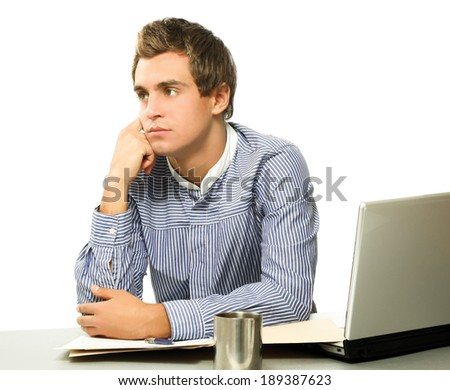 handsome young man working with laptop - stock photo