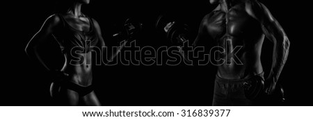 handsome young muscular man doing exercises with dumbbells - stock photo