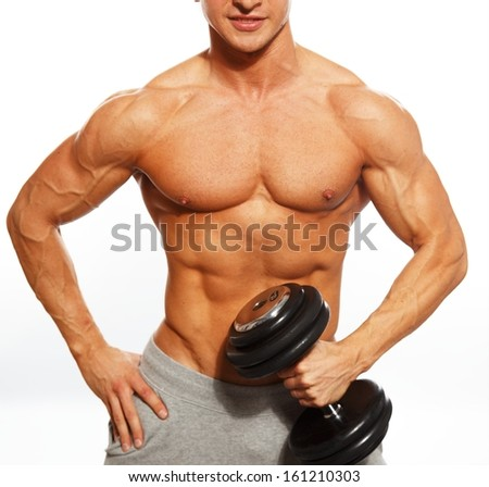 Handsome young muscular man exercising with dumbbells - stock photo