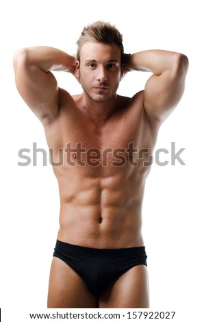 Handsome young muscular man showing ripped abs, isolated on white - stock photo