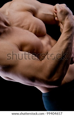 handsome young muscular sports man on black background - stock photo