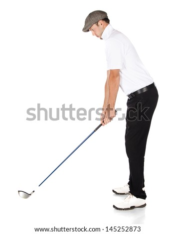 Handsome young professional golf player wearing a white shirt and black pants. He is holding a golf club and preparing for his shot. - stock photo