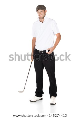 Handsome young professional golf player wearing a white shirt and black pants. He is holding a golf ball and a golf club and smiling at the camera. - stock photo