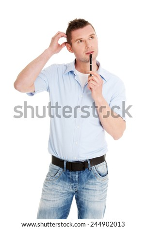 Handsome young thoughtful man wondering - stock photo